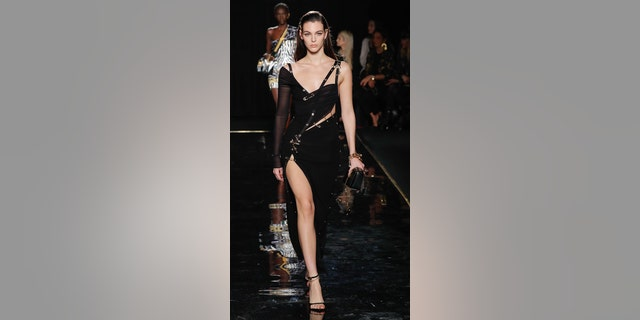 A model walks the runway at the Versace Pre-Fall 2019 Collection at The American Stock Exchange on Dec. 02, 2018 in New York City.