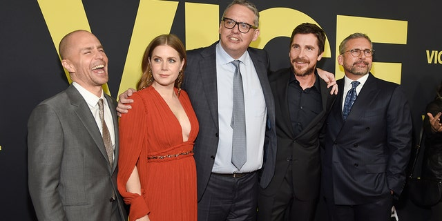 """Sam Rockwell, from left, Amy Adams, writer/director Adam McKay, Christian Bale and Steve Carell arrive at the world premiere of """"Vice"""" on Tuesday, Dec. 11, 2018, at the Samuel Goldwyn Theater in Beverly Hills, Calif."""
