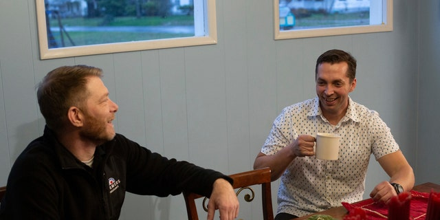 Vince Villano, left, and Justin McNeil, right, were connected by McNeil's wife, who has been prepping Villano's morning coffee order at Starbucks for the last several years.