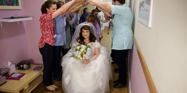 Tasha Burton, 36, was admitted to the inpatient unit at the Hospice of St Francis, in Berkhamsted, on Nov. 27, and on Nov. 28, she and her fiance, Daniel Corley, walked down the aisle.