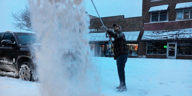 Travelers during the holidays had it as a winter storm hard to drive panned snow and lashed Thursday's gusty winds through parts of the Dakotas and Minnesota. (John Enger / Minnesota Public Radio via AP)