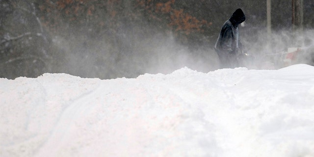 Forecasters posted a blizzard warning for parts of the Dakotas and Minnesota as a major winter storm delivered heavy snow and gusty winds to the region. (Mike McCleary/The Bismarck Tribune via AP)