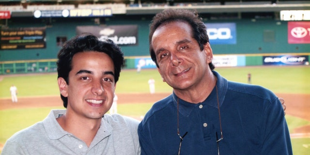 Charles Krauthammer with his son Daniel at RFK Stadium in 2007.