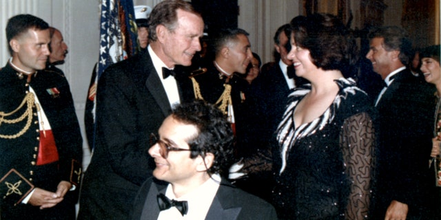 Charles Krauthammer with his wife Robyn at the White House with President George H.W. Bush.