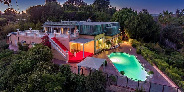 This classic 1950s Bel Air mansion is also rumored to have been occupied by Howard Hughes and Elvis Presley.