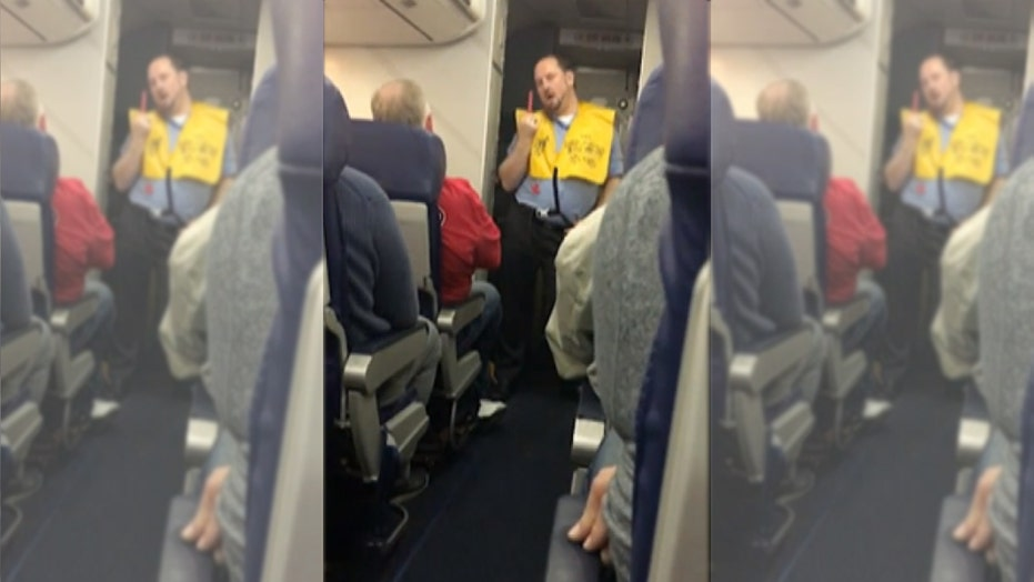 Flight attendant does striptease-like dance during safety demo
