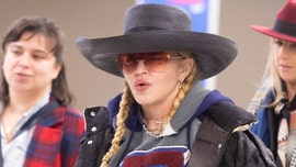 Madonna can't stop wearing her $5,500 puffer coat