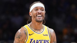 Los Angeles Lakers' Michael Beasley attempts to enter game with wrong shorts