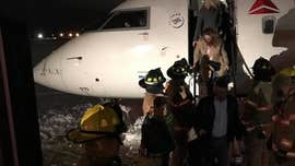 SkyWest flight slides off taxiway at Indiana airport amid icy conditions