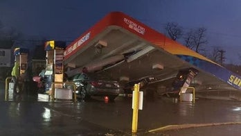 Gas station canopy collapses, damaging two vehicles, fuel pumps underneath: report