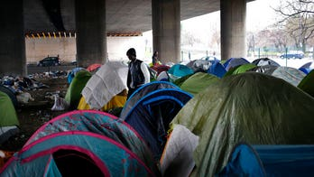 Thousands of migrants set up camps in Paris as authorities scramble to cope