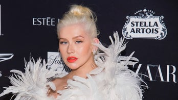Christina Aguilera breaks down while receiving award from domestic violence shelter: 'I'm a survivor of it'