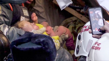 Russian infant rescued alive 35 hours after building collapse in subzero cold