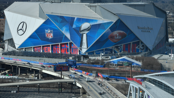 Reporter's Notebook: Getting around Super Bowl event poses 'uber' problems