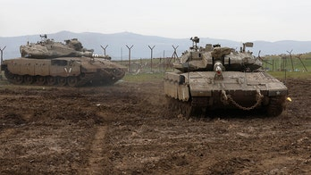 Israel, in rare move, announces attacks on Iranian targets in Syria, delivers warning
