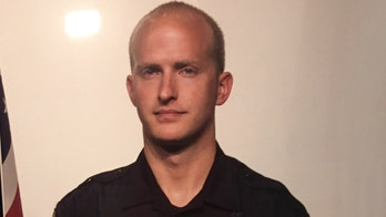 Utah police officer shot, killed while attempting to arrest fugitive, officials say