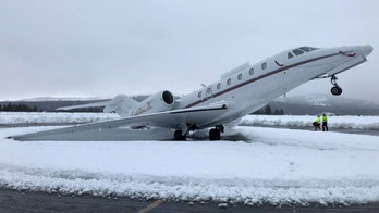 Heavy 'Sierra cement' snow causes jet to pop a wheelie as storm brings blizzard conditions to California