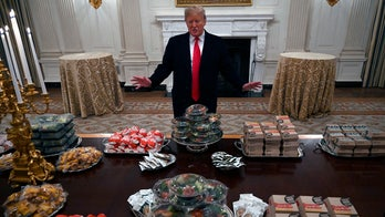 Trump serves burgers, fries and pizza to college football champions Clemson
