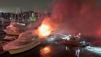 Boston fire crews battle flames in Charlestown marina; 2 boats sink, officials say