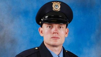 Raleigh cop, now fighting for his life, was shot multiple times at close range, report says