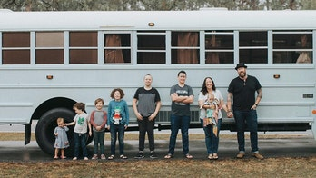 Family of nine travels the country in a converted school bus, 'unschools' kids on the road