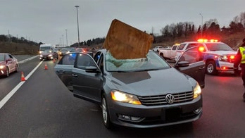 Cutting it close: Car impaled by flying piece of plywood