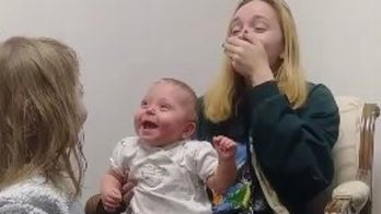 Baby erupts in laughter after hearing clearly for first time