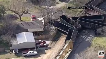 Freight train derails into backyard, narrowly missing house