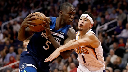 Phoenix Suns' Devin Booker seen rushing to tunnel to meet Timberwolves' Gorgui Dieng after ejections