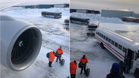 United Airlines passengers stranded on plane for over 14 hours at freezing airport in Canada