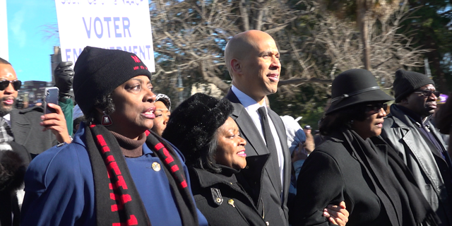 Sen. Cory Booker leads the march to South Carolina's State House on Martin Luther King Jr. Day.