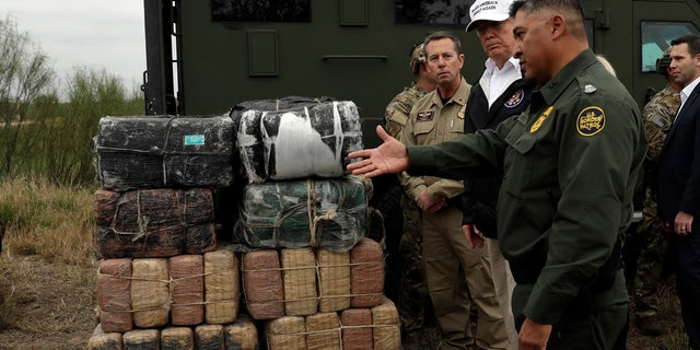 President Donald Trump tours the U.S. border with Mexico at the Rio Grande on the southern border, Thursday, Jan. 10, 2019, in McAllen, Texas.