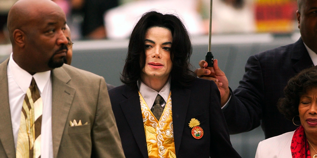 FILE - In this May 25, 2005 file photo, Michael Jackson arrives at the Santa Barbara County Courthouse for his child molestation trial in Santa Maria, Calif.