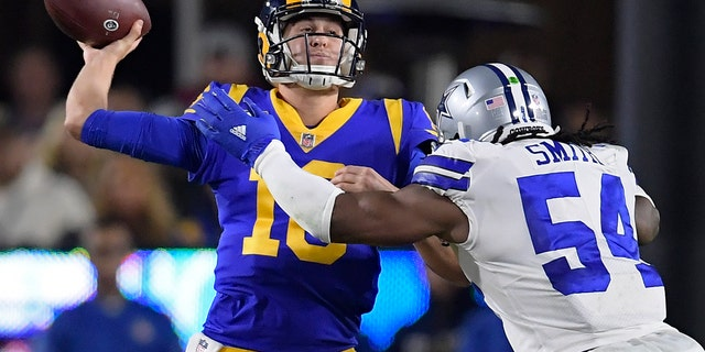 Los Angeles Rams quarterback Jared Goff passes under pressure from Dallas Cowboys middle linebacker Jaylon Smith during the first half in an NFL divisional football playoff game Saturday, Jan. 12, 2019, in Los Angeles.