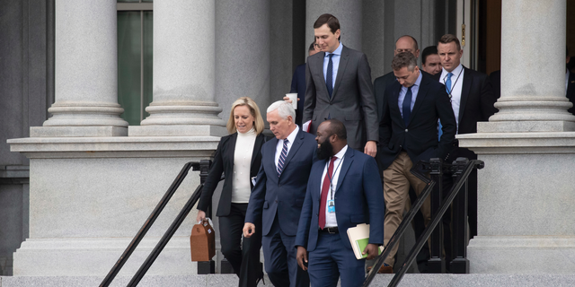 Homeland Security Secretary Kirstjen Nielsen, left, Vice President Mike Pence, White House legislative affairs aide Ja'Ron Smith, followed by White House Senior Adviser Jared Kushner, and others, leaving a meeting with staff members of House and Senate leadership Saturday in Washington. (AP Photo/Alex Brandon)