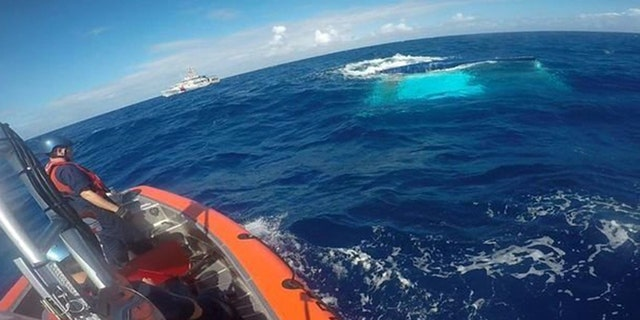 The Coast Guard can be seen finding the sunken ship in this image