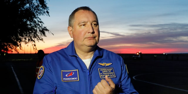 In this Thursday, Oct. 11, 2018 file photo, Director General of the Russia state corporation Roscosmos Dmitry Rogozin walks in Baikonur airport, in Kazakhstan.