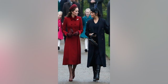 Britain's Kate, Duchess of Cambridge, left, and Meghan Duchess of Sussex, right, arrive to attend the Christmas day service at St Mary Magdalene Church in Sandringham in Norfolk, England, Tuesday, Dec. 25, 2018. (AP PhotoFrank Augstein)