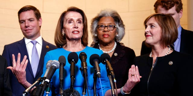 FILE - In this Nov. 28, 2018, file photo, House Minority Leader Nancy Pelosi, D-Calif., joined by from left, Rep. Eric Swalwell, D-Calif., Rep. Joyce Beatty, D-Ohio., and Rep. Kathy Castor, D-Fla., speaks to media at Longworth House Office Building on Capitol Hill in Washington, Wednesday, to announce her nomination by House Democrats to lead them in the new Congress. Pelosi has appointed Castor to lead a special committee on climate change that replaces one eliminated by Republicans in 2011. (AP Photo/Carolyn Kaster, File)