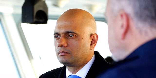 Britain's Home Secretary Sajid Javid, meets Border Force staff on board HMC Searcher, in Dover, England, Wednesday, Jan. 2, 2019.  (Gareth Fuller/PA via AP)