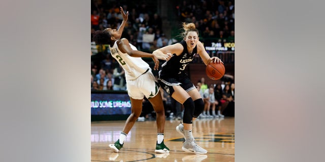 Connecticut guard/forward Katie Lou Samuelson (33) is fouled by Baylor guard Didi Richards (2) during the first half of an NCAA college basketball game on Thursday, Jan. 3, 2019, in Waco, Texas. (AP Photo/Ray Carlin)