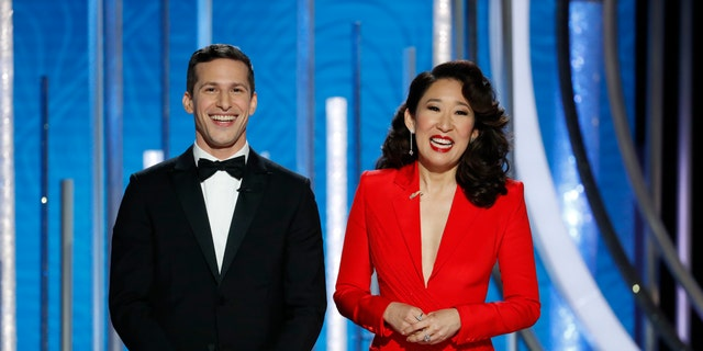 This image released by NBC shows hosts Andy Samberg, left, and Sandra Oh at the 76th Annual Golden Globe Awards at the Beverly Hilton Hotel on Sunday, Jan. 6, 2019,.