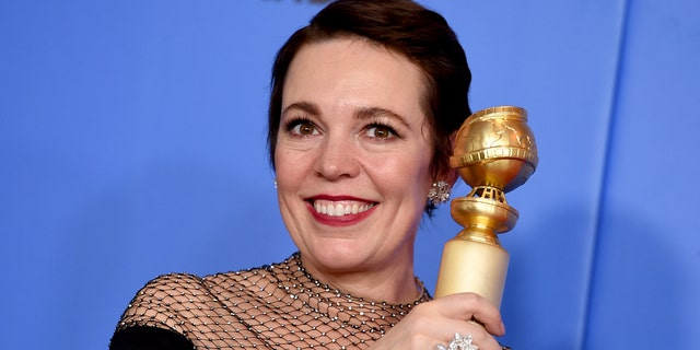 "Olivia Colman poses in the press room with the award for best performance by an actress in a motion picture, musical or comedy for ""The Favourite"" at the 76th annual Golden Globe Awards at the Beverly Hilton Hotel on Sunday, Jan. 6, 2019, in Beverly Hills, Calif. (Photo by Jordan Strauss/Invision/AP)"