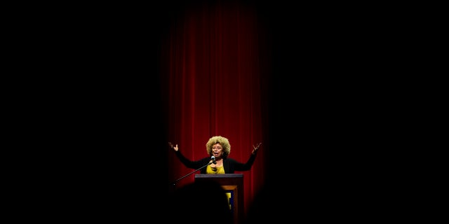 Angela Davis, author, educator and iconic civil rights activist, speaks during her visit to the University of Michigan-Flint, in Flint, Mich. (Jake May/The Flint Journal via AP, File)