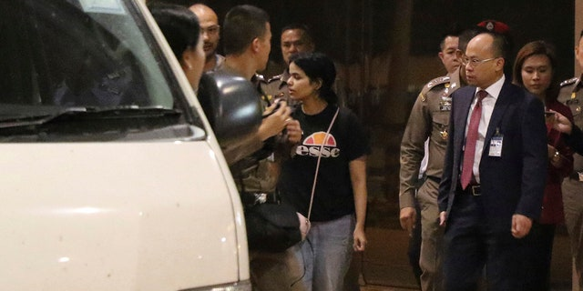 Rahaf Mohammed Alqunun,who says she is fleeing abuse by her family and wants asylum in Australia, leaves the Suvarnabhumi Airport in Bangkok Monday. (AP Photo)