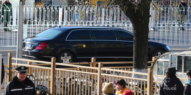 A stretch limousine with a golden emblem, similar to one North Korean leader Kim Jong Un has used previously, is seen leaving a train station with a convoy in Beijing, China, Tuesday, Jan. 8, 2019.