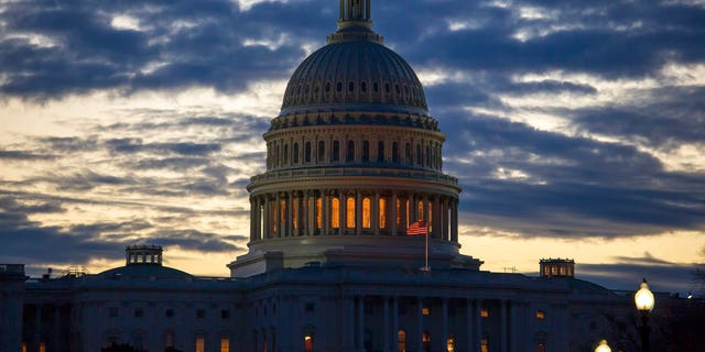 Dawn arrives at the Capitol in Washington, as the partial government shutdown enters day 18, Tuesday, Jan. 8, 2019, as President Donald Trump holds to his border wall funding demands. Trump will speak to the nation tonight about the border in a televised address from the Oval Office. (AP Photo/J. Scott Applewhite)