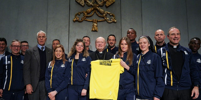From left, CONI Italian Olympic Committee President Giovanni Malago', Cardinal Gianfranco Ravasi, President of the Pontifical Council for Culture and Melichor Jose' Sanchez de Toca y Alameda, right, pose for photos at the end of a press conference, at the Vatican.