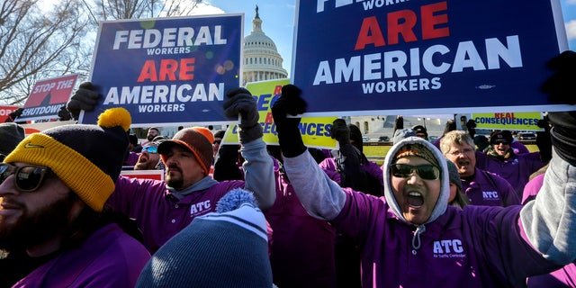 On the Twentieth day of a partial executive shutdown, federal workers rally at the Capitol to mutter the impasse between Congress and President Donald Trump over his demand to fund a U.S.-Mexico border wall, in Washington, Thursday, Jan. 10, 2019. (AP Portray/J. Scott Applewhite)