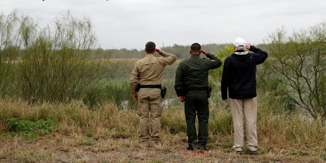 President Donald Trump salutes as he tours the U.S. border with Mexico at the Rio Grande on the southern border, Thursday, Jan. 10, 2019, in McAllen, Texas. (AP Photo/ Evan Vucci)